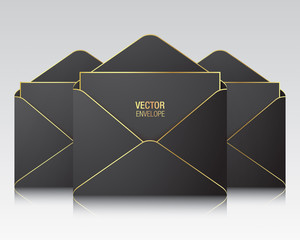 Black vector envelope templates. Three black opened envelopes with golden elements, standing on a white background. Realistic mockup.