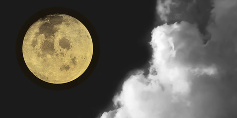 Dramatic atmosphere panorama view of night sky background with beautiful super moon and clouds.Image of moon furnished by NASA.