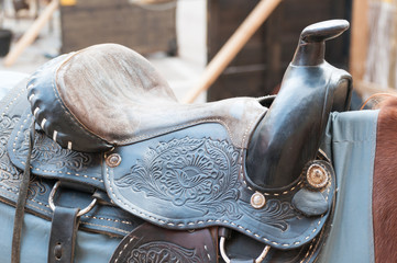 horse with saddle in a stable