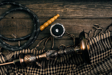 Dismantled parts of hookah on wooden background.