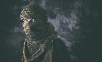Masked criminal portrait with grungy background concept