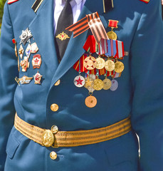 A veteran soldier decorated with medals the celebration of the Victory Day