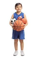 Little boy holding sports balls