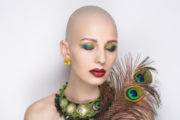 woman with peacock feathers