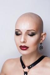 wet bald woman