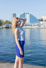 Tall young woman posing on seafront