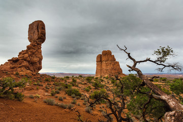 Balanced Rock, Arches National Park, Utah, profiled on stormy sky