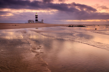 Lighthouse lansdcape with reflections in the water and moody sky, Cape Recife, Port Elizabeth, South Africa