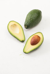 Ripe sliced avocado on a white table