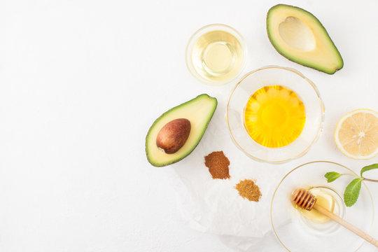 Recipes avocado with honey on white background