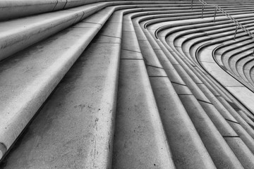 Architectural monochrome cement stairs with lead-in lines and metal railing