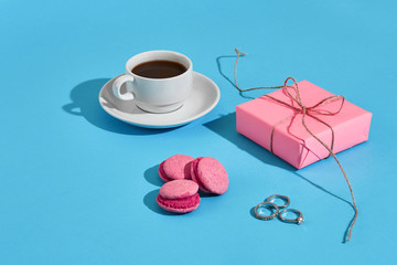 Valentine's day greeting card. White coffee cup, pink macaroons