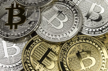 Many Bitcoin coins with currency symbol laying