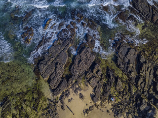 Rocky shoreline aerial view from above, sea, rocks, sand