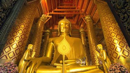 Golden Buddha statue in the Wat Phanan Choeng Temple, Ayutthaya, Thailand
