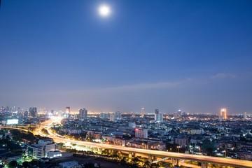 Bangkok Cityscape beside river during twilight time