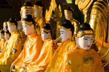 Buddhas at the golden Shwedagon pagoda in Yangon or Rangoon, Myanmar