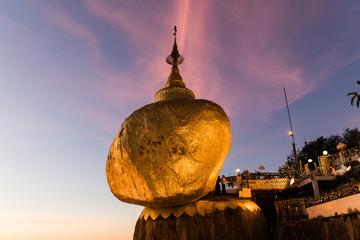 Kyaikhtiyo or Kyaiktiyo pagoda, Golden Rock, Myanmar with pilgrims during sunset