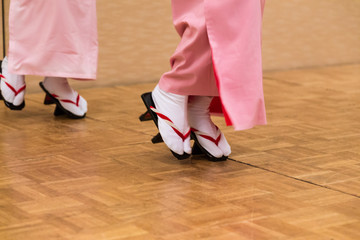 Japanese women dancing in traditioanl dress and geta shoes
