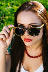 Woman with red lips in glasses,girl with sunglasses,copyspace