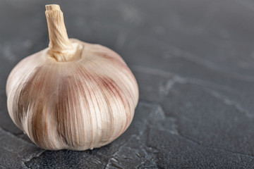 garlic on a wooden background healthy lifestyle