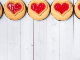 Homemade Cookies with a Red Jam Heart Valentine's Day White Wooden Background Copy Space
