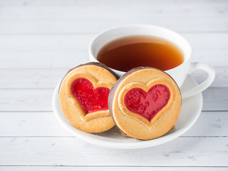 Homemade Cookies with a Red Jam Heart Valentine's Day Cup of tea