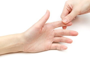 Woman holding her hand and a finger, pain concept, isolate on white background.