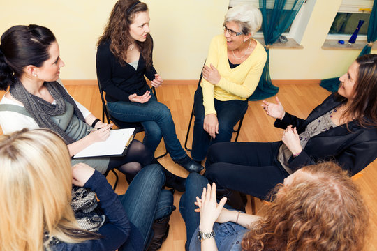 Group Of Women Sitting In A Circle, Discussing