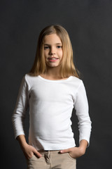 Child model with long hair in white shirt