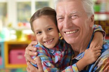 Grandfather and granddaughter having fun