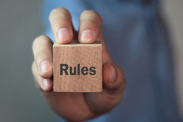 Rules text on a wooden cube.