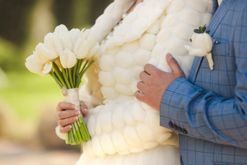 Wedding bouquet of white tulips in bride hands