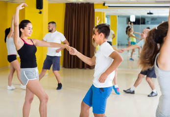 Group of dancers are dancing boogie-woogie in pairs