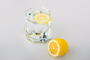 Sliced lemon with glass of water on the table