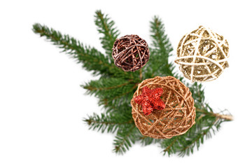 Wicker Christmas ornaments stock images. Christmas decoration on a white background. Spruce twig with christmas balls. Elegant holiday background