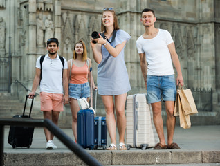 Young couple taking pictures outdoors in trip