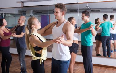 Ordinary adults dancing bachata together