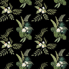 Tropical print. Exotic flowers and leaves. Seamless pattern.