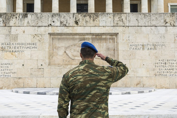 Elite soldier of the presidential guard at attention  front of the monument of the Unknown Soldier in Athens, Greece.