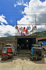 Colorist tricycles on Mayoyao-Alfonso Lista-Isabela road. Banaue town-Ifugao province-Luzon-Philippines. 0076
