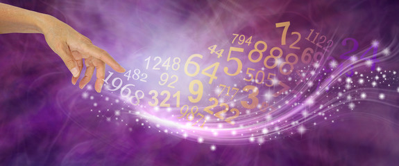 Numerology is far more than just NUMBERS - female hand appearing to create a swish of sparkles and a flow of random numbers on a pink purple energy formation background