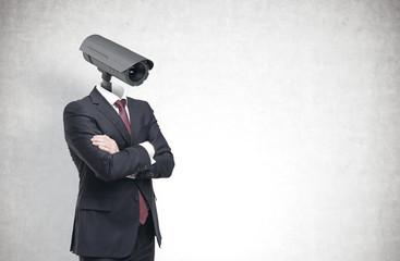 Man with a CCTV camera head, concrete