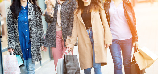Group of happy friends shopping together.