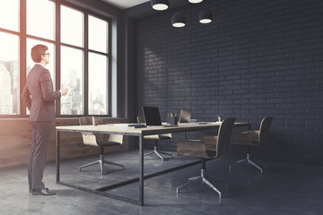 Black brick open space office corner toned
