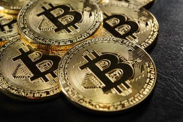 Golden bitcoins on luxury dark leather