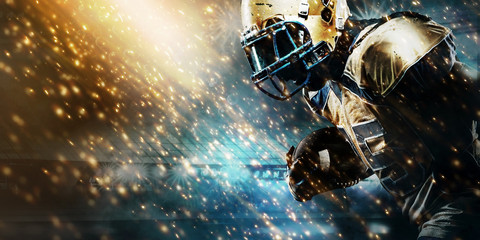 American football sportsman player on stadium running in action. Sport wallpaper with copyspace.