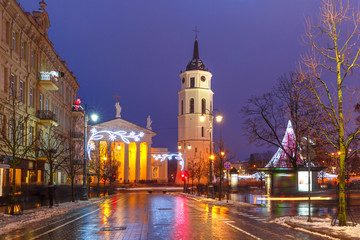 Decorated and illuminated Christmas Gediminas prospect and Cathedral Belfry during evening blue hour, Vilnius, Lithuania, Baltic states.