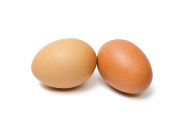 Two brown chicken egg isolated on white background
