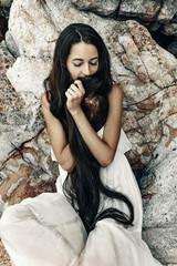 beautiful young boho style woman in white dress
